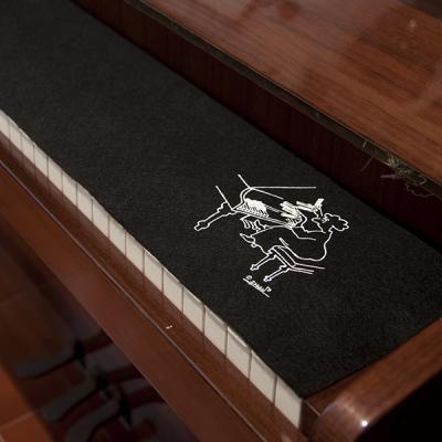 Cubre teclas piano mujer